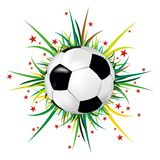 Soccer ball on background of grass and stars Royalty Free Stock Image