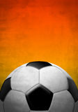 Soccer ball on a background of red color. Soccer ball on a textured background on a texture background with red colors Royalty Free Stock Photography