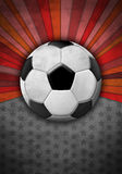 Soccer ball on a background of red colors. Soccer ball on a textured background with red colors, poster - card template Royalty Free Stock Photos