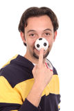 Soccer ball balanced on finger Royalty Free Stock Image