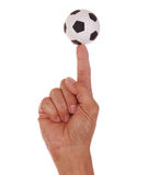 Soccer Ball Balanced on Finger Royalty Free Stock Images