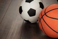 Soccer ball and basketball on the table Stock Image