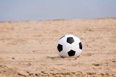 Soccer ball on beach Stock Photography