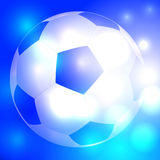 Soccer ball on beautiful glowing blue background Royalty Free Stock Image