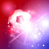 Soccer ball on beautiful glowing  blue and red background Royalty Free Stock Photo
