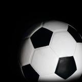 Soccer ball in black Stock Photos