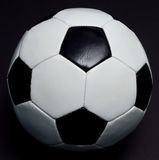 Soccer ball on black Stock Images