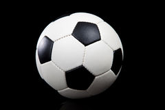 Soccer ball on a black background Royalty Free Stock Photo