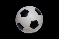 Soccer ball. On black background Stock Images