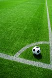 Soccer, football, ball, on corner spot, white marks, classic black and white on clean green field, space for text, good for banner. Soccer ball black and white stock photo