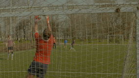 Soccer ball blazing out the crossbar after kick stock video