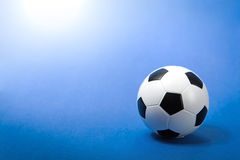 Soccer ball on blue Stock Photos