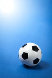 Soccer ball on blue Stock Image