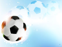 Soccer ball on  blue background Royalty Free Stock Photography