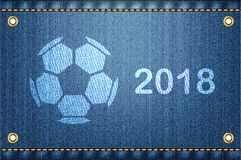 Soccer ball on blue jeans background. 2018 Stock Images