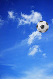 Soccer ball on blue sky Royalty Free Stock Photos