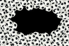 Soccer ball border over black background Stock Photo