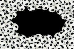 Soccer ball border over black background Stock Photo