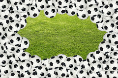 Soccer ball border over green grass. Soccer ball border with green grass copy space background in the center stock photos