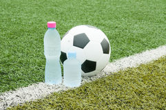 Soccer ball and bottles of cold wate Royalty Free Stock Photo