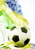 Soccer ball of Brazil 2014. Covered in smoke Stock Photos