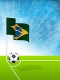 Soccer ball and Brazil flag. In field corner Stock Photo