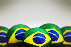 Soccer ball with Brazil flag. On gray background, 3d render royalty free stock images