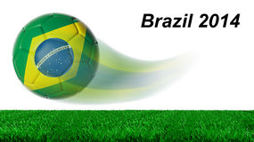 Soccer ball with Brazil flag. In motion with grass isolated Royalty Free Stock Photo
