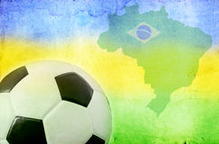 Soccer ball, Brazil map and colors of the flag. Vintage photo of soccer ball, Brazil map and the colors of the flag royalty free stock photo