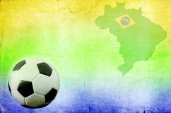 Soccer ball, Brazil map and colors of the flag. Vintage photo of soccer ball, Brazil map and the colors of the flag royalty free stock photography