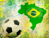 Soccer ball, Brazil map and colors of the flag. Vintage photo of soccer ball, Brazil map and the colors of the flag royalty free stock photos