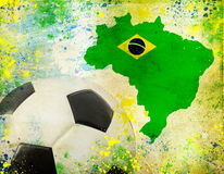 Soccer ball, Brazil map and colors of the flag. Vintage photo of soccer ball, Brazil map and the colors of the flag royalty free stock images