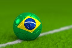 Soccer Ball With Brazilian Flag 3D Render. A soccer ball with a brazilian flag on green grass Royalty Free Stock Photos