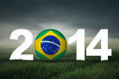 Soccer ball with brazilian flag. On the field symbolizing soccer championship of 2014 Stock Photography