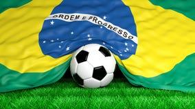 Soccer ball with Brazilian flag. On football field closeup Royalty Free Stock Photo