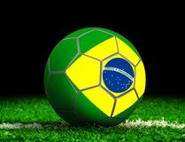 Soccer Ball with Brazilian Flag on Grass Stock Images