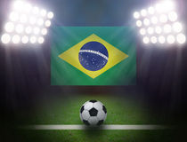 Soccer Ball with Brazilian in stadium. Soccer Ball with Brazilian Flag,bright spotlights Royalty Free Stock Image