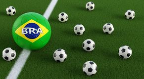 Soccer ball in brazils national colors on a soccer field. 3D Rendering Stock Photo