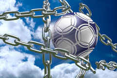 Soccer Ball Breaking Through Chains. 3D soccer ball tearing silver chains apart Royalty Free Stock Photo