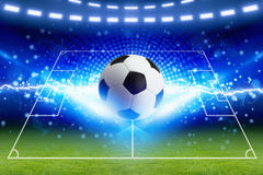 Soccer ball, bright blue lightning, green football field with la Stock Photography