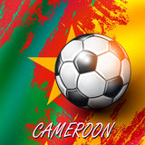 Soccer ball on Cameroon flag background. Royalty Free Stock Images