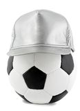 Soccer ball and cap Royalty Free Stock Photography
