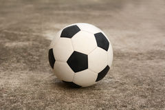 Soccer ball on the cement floor. Soccer ball on the old cement floor royalty free stock image