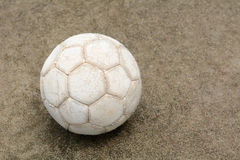 Soccer ball on the cement floor. Soccer ball on the old cement floor Stock Image