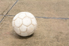 Soccer ball on the cement floor. Soccer ball on the old cement floor Stock Photo