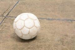 Soccer ball on the cement floor. Soccer ball on the old cement floor stock photo