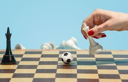 Soccer ball of chess pieces on the board. Football stratrgy. Soccer ball of chess pieces on the board. Game concept. Business ideas, competition, strategy and Stock Photos