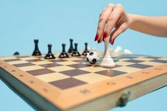 Soccer ball of chess pieces on the board. Football stratrgy. Soccer ball of chess pieces on the board. Game concept. Business ideas, competition, strategy and Stock Image