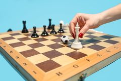 Soccer ball of chess pieces on the board. Football stratrgy. Soccer ball of chess pieces on the board. Game concept. Business ideas, competition, strategy and Royalty Free Stock Photos