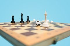 Soccer ball of chess pieces on the board. Football stratrgy. Soccer ball of chess pieces on the board. Game concept. Business ideas, competition, strategy and Stock Images